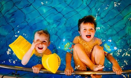 two boys playing in swimming pool